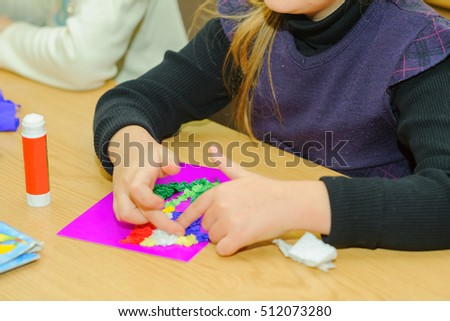 Children at a lesson of the fine arts, are engaged in application and a drawing, decorate on contours, I paste strips of color paper, prepare gifts for holidays #512073280