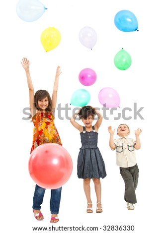 children at a party jumping and playing with balloons