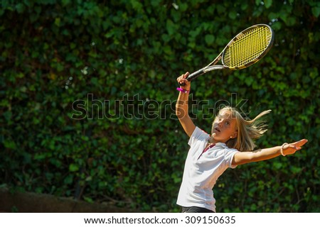 Children at school during a dribble of tennis