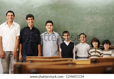 Children at school from smaller to bigger line row