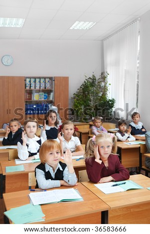 Children at school. Real lesson in classroom. - stock photo