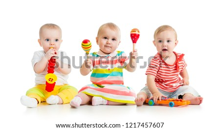 Children babies toddlers playing with musical toys. Isolated on white background
