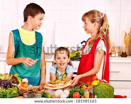 Children bake cookies at  kitchen.