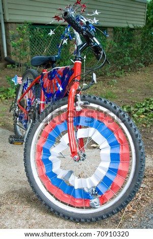Children bike decorated in american flags prepared for 4th July parade