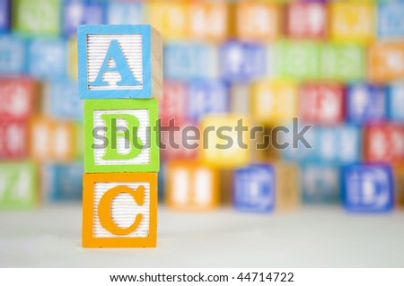 Children blocks with ABC spelled out on a colorful background