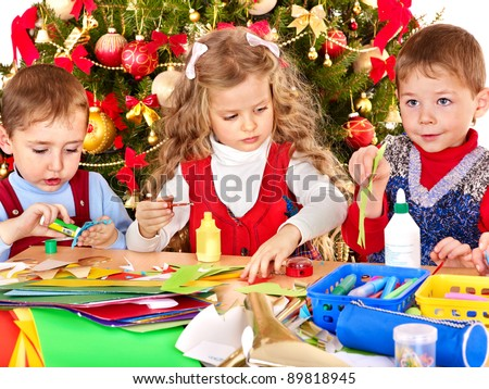 Children boy and girl making decoration for Christmas.