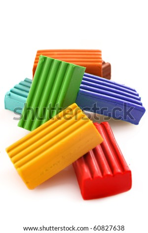 Children bright coloured plasticine set chaotically isolated on white