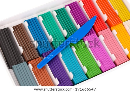 Children bright plasticine in paper box with stack isolated on white