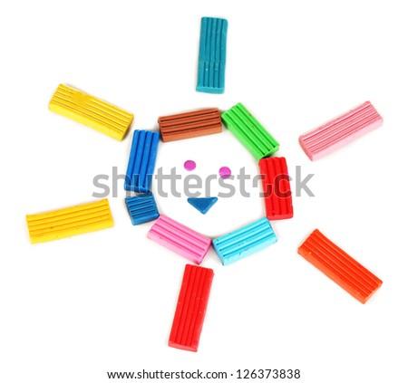 Children bright plasticine isolated on white