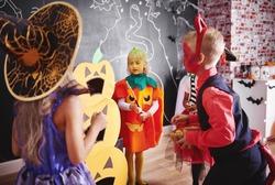 Children celebrating halloween at home