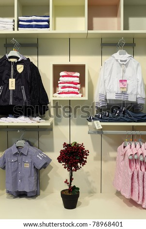 stock photo : children clothing store, clothing on shelves, hangers with ...