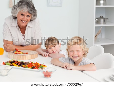 Children cooking with their grandmother at home