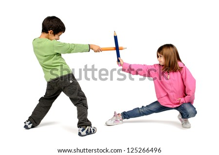 Children couple playing with large pencils isolated in white - stock photo