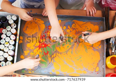 children draw drawing technique with ebru  Stok fotoğraf ©