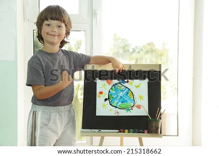 Children draw planet earth in home