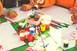 children draw with parents paint beautiful pictures, children's creativity