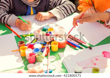 children draw with parents paint beautiful pictures, children's creativity Сток-фото ©