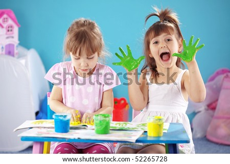 Children drawing in the nursery - stock photo