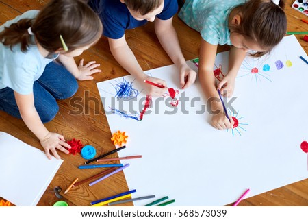 Children Drawing Together #568573039