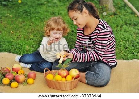 children eat a tangerine ...