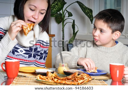 Children eat pancakes