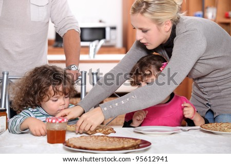 Children eating crepes
