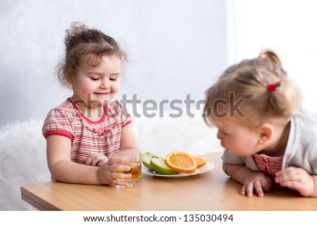 children eating healthy food in kitchen