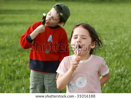 children eating ice cream on a stick, wolf down