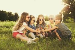 Children eating lollipops during summertime fun