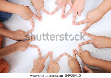 Children fingers, hands in circle, making a star - stock photo