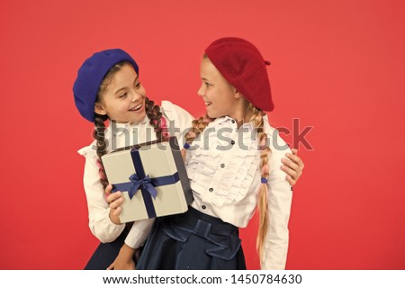 Children formal wear with gift box. Open gift now. Friendship concept. Birthday present. Shopping and holidays. For my dear friend. Girl giving gift box to friend. Girls friends celebrate holiday.