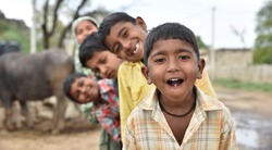 Children from rural India smiling and having good time