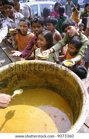 Children getting free food in the streets of Delhi, India