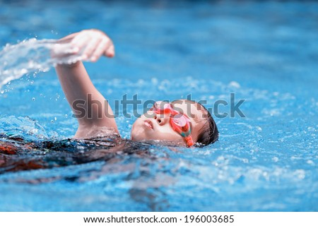 children girl in swimming pool