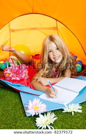 Children girl writing a notebook in camping tent with flowers