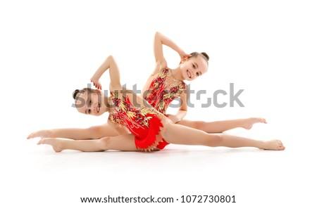 children girls gymnast doing sports in rhythmic gymnastics on white background