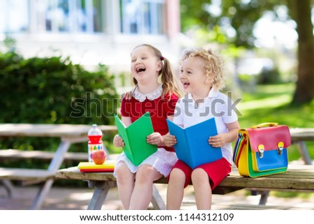 Children go back to school. Start of new school year after summer vacation. Boy and girl with backpack and books on first school day. Beginning of class. Education for kindergarten and preschool kids. #1144312109