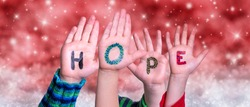 Children Hands Building Word Hope, Red Christmas Background