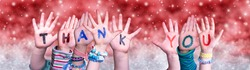Children Hands Building Word Thank You, Red Christmas Background