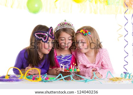 children happy girls blowing birthday party chocolate cake candles