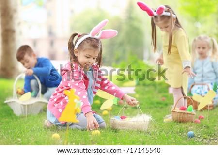 Shutterstock Children having fun in park. Easter egg hunt concept