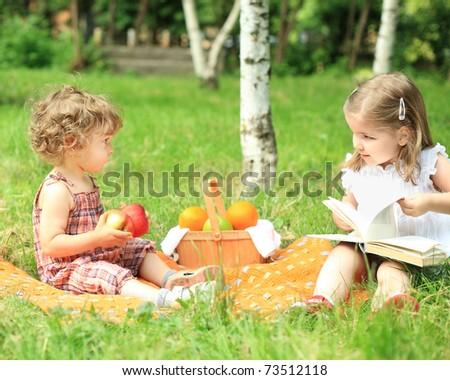 Children having picnic in summer park