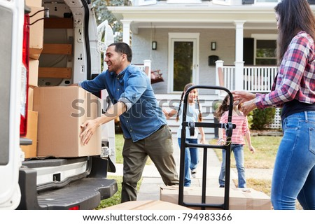 Children Helping Unload Boxes From Van On Family Moving In Day #794983366