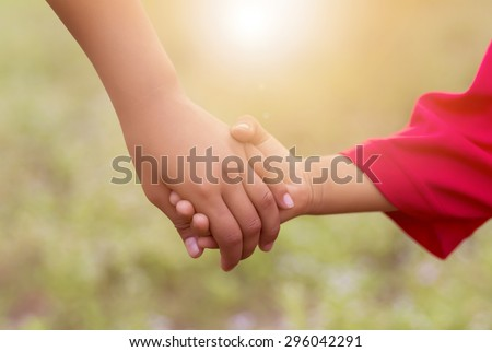 children holding hands sunlight,happy