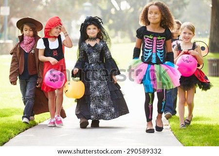 Children In Fancy Costume Dress Going Trick Or Treating Stock photo ©