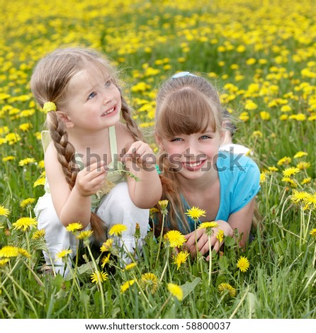 Children in field with flower. Outdoor. - stock photo