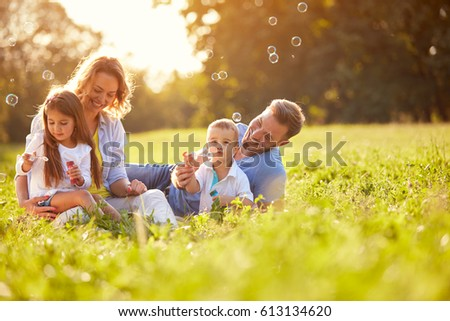 Shutterstock Children in green nature make soap bubble on summer