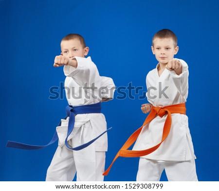 Children in karategi beats blows hand #1529308799