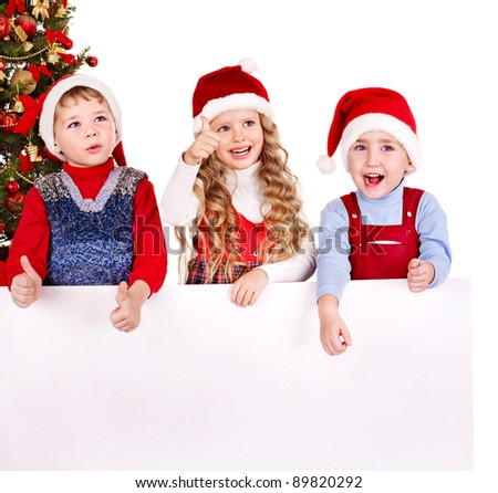 Children in Santa hat with banner near Christmas tree. Isolated. - stock photo