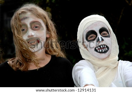 children in scary costumes